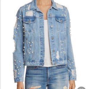 Distressed and embellished denim jacket